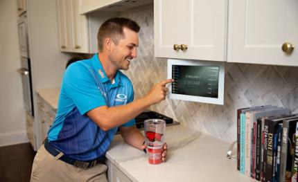 PGA pro golfer controls his home from the course with ELAN