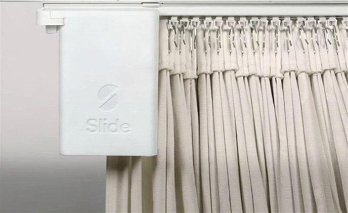 'Slide' turns existing curtains into a smart curtain system in two minutes
